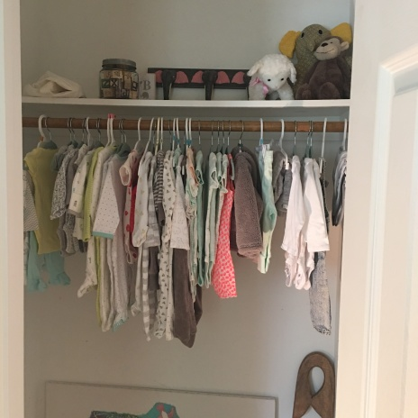 The nursery closet with the start of her sweet clothes!